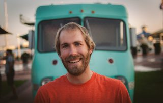 Color image of Evan Harrell, owner of Panavoir food truck