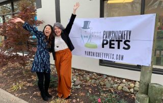 Photo of Pawsnickety Pets owners on grand opening day