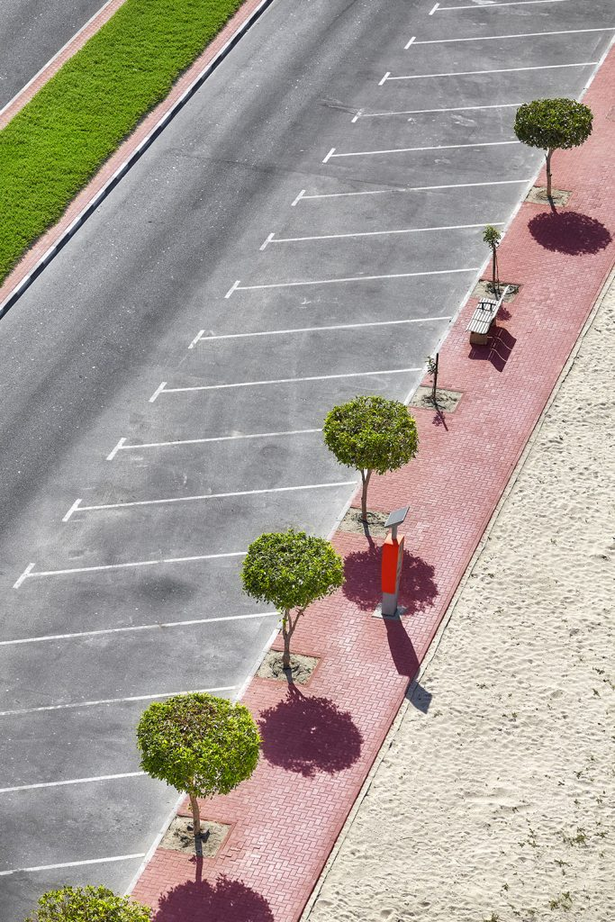Aerial photo of an empty parking lot with nice trees