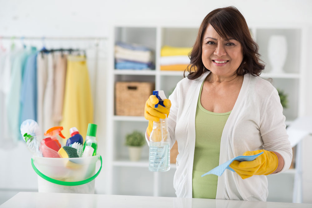 Woman holding cleaning products in store